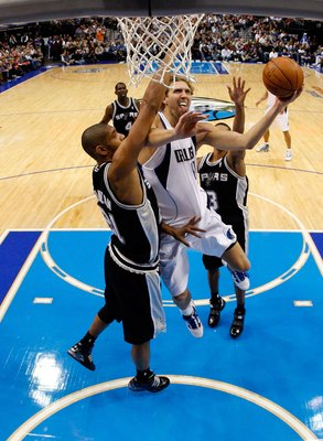 DALLAS - NOVEMBER 18:  Forward Dirk Nowitzki #41 of the Dallas Mavericks takes a shot against Tim Duncan #21 of the San Antonio Spurs on November 18, 2009 at American Airlines Center in Dallas, Texas.  NOTE TO USER: User expressly acknowledges and agrees