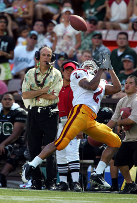 HONOLULU, HI -  SEPTEMBER 3:  Steve Smith #2 of USC makes an over the head catch on the sidelines during a  63-17 win over Hawaii at Aloha Stadium on September 3, 2005 in Honolulu, Hawaii.  (Photo by Harry How/Getty Images)
