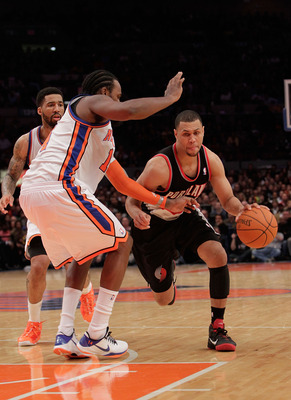 NEW YORK - OCTOBER 30:  Brandon Roy #7 of the Portland Trail Blazer drives the ball past Ronny Turiaf #14 of the New York Knicks at Madison Square Garden on October 30, 2010 in New York City. NOTE TO USER: User expressly acknowledges and agrees that, by d