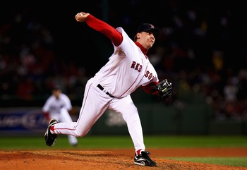 BOSTON - OCTOBER 13:  Starting pitcher Curt Schilling #38 of the Boston Red Sox pitches in the first inning of Game Two of the American League Championship Series against the Cleveland Indians at Fenway Park on October 13, 2007 in Boston, Massachusetts.