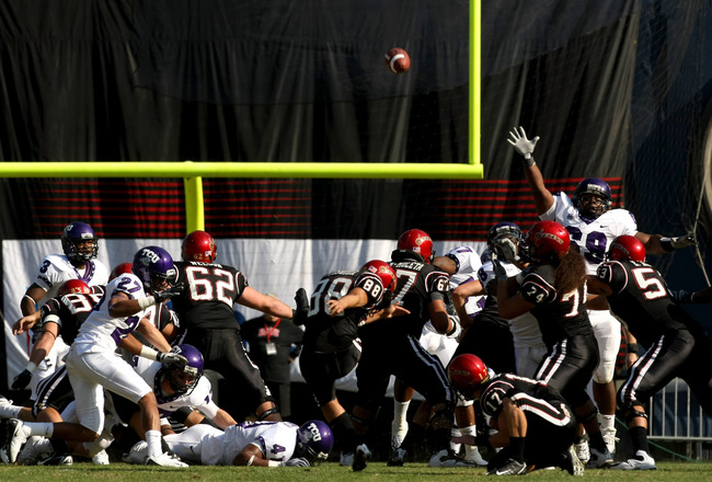 SAN DIEGO - NOVEMBER 7:  Kicker Lane Yoshida #88 of the San Diego State Aztecs kicks a 48 yard field goal in the second quarter against the Texas Christian University Horned Frogs on November 7, 2009 at Qualcomm Stadium in San Diego, California.   TCU won