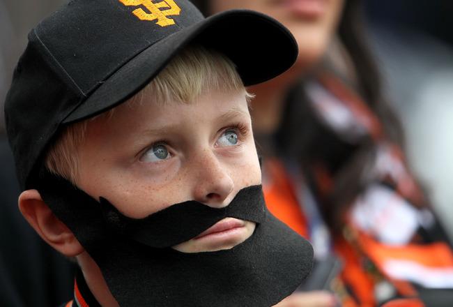 SAN FRANCISCO - OCTOBER 28:  A San Francisco Giants fan watches batting practice before Game Two of the 2010 MLB World Series agains the Texas Rangers at AT&T Park on October 28, 2010 in San Francisco, California.  (Photo by Justin Sullivan/Getty Images)