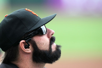 SAN FRANCISCO - OCTOBER 28:  Brian Wilson #38 of the San Francisco Giants looks on during batting practice before Game Two of the 2010 MLB World Series against the Texas Rangers at AT&T Park on October 28, 2010 in San Francisco, California.  (Photo by Jus