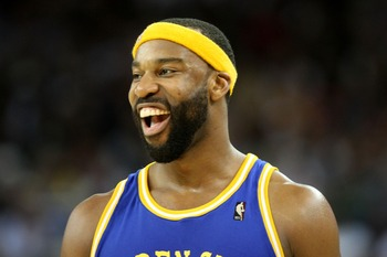OAKLAND, CA - JANUARY 7:  Baron Davis #5 of the Golden State Warriors smiles during an NBA game against the San Antonio Spurs at Oracle Arena January 7, 2008 in Oakland, California. NOTE TO USER: User expressly acknowledges and agrees that, by downloading