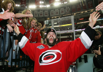 RALEIGH, NC - JUNE 19:  Bret Hedican #6 of the Carolina Hurricanes celebrates after defeating the Edmonton Oilers in game seven of the 2006 NHL Stanley Cup Finals on June 19, 2006 at the RBC Center in Raleigh, North Carolina. The Hurricanes defeated the O