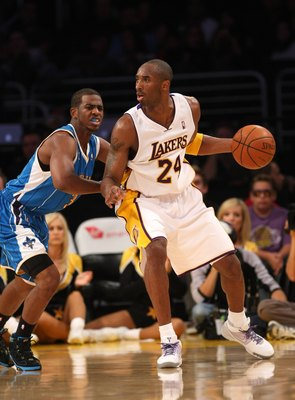 LOS ANGELES, CA - NOVEMBER 08:  Kobe Bryant #24 of the Los Angeles Lakers ccontrols the ball against Chris Paul #3 of the New Orleans Hornets on November 8, 2009 at Staples Center in Los Angeles, California.  NOTE TO USER: User expressly acknowledges and