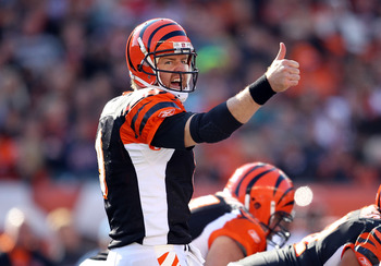 CINCINNATI - OCTOBER 31:  Carson Palmer #9 of  the Cincinnati Bengals gives instructions to his team during the NFL game against the Miami Dolphins at Paul Brown Stadium on October 31, 2010 in Cincinnati, Ohio.  (Photo by Andy Lyons/Getty Images)