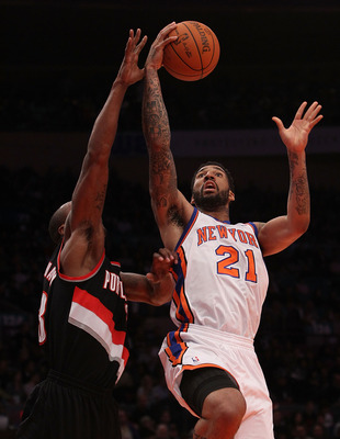 NEW YORK - OCTOBER 30: Wilson Chandler #21 of the New York Knicks lays the ball up against Dante Cunningham #33 of the Portland Trail Blazers at Madison Square Garden on October 30, 2010 in New York City. NOTE TO USER: User expressly acknowledges and agre