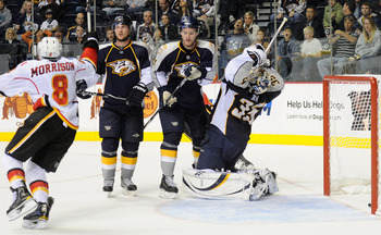 NASHVILLE, TN - OCTOBER 19:  Goalie Pekka Rinne #35 of the Nashville Predators reacts after giving up the game winning overtime goal as Predators defensemen Kevin Klein #8 and Cody Franson #4 watch Brendan Morrison #8 of the Calgary Flames celebrate on Oc