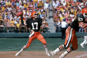SAN DIEGO - SEPTEMBER 25:  Quarterback Brian Sipe #17 of the Cleveland Browns throws a pass under the protection of offensive tackle Cody Risien #63 during a game against the San Diego Chargers at Jack Murphy on September 25, 1983 in San Diego, California