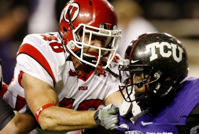 FORT WORTH, TX - NOVEMBER 14:  Lolo Tenifa #46 of the Utah Utes tries to stop Jeremy Kerley #85 of the TCU Horned Frogs at Amon G. Carter Stadium on November 14, 2009 in Fort Worth, Texas.  (Photo by Ronald Martinez/Getty Images)
