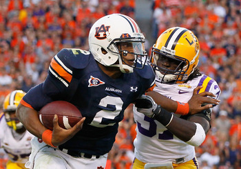 AUBURN, AL - OCTOBER 23:  Quarterback Cameron Newton #2 of the Auburn Tigers stiff arms Karnell Hatcher #37 of the LSU Tigers at Jordan-Hare Stadium on October 23, 2010 in Auburn, Alabama.  (Photo by Kevin C. Cox/Getty Images)