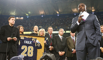 ST. LOUIS - DECEMBER 20:   Former running back Marshall Faulk of the St. Louis Rams addresses the fans during a halftime ceremony to retire his jersey on December 20, 2007 at Edward Jones Dome in St. Louis, Missouri.  (Photo by Elsa/Getty Images)