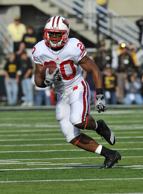 IOWA CITY, IA - OCTOBER 23- Running back James White #20 of the Wisconsin Badgers drives the ball down field against the University of Iowa Hawkeyes during the first half of play at Kinnick Stadium on October 23, 2010 in Iowa City, Iowa. Wisconsin won 31-