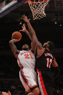 NEW YORK - OCTOBER 30: Wilson Chandler #21 of the New York Knicks shoots the ball against LaMarcus Aldridge #12 of the Portland Trail Blazers at Madison Square Garden on October 30, 2010 in New York City. NOTE TO USER: User expressly acknowledges and agre