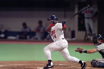 MINNEAPOLIS - OCTOBER 20:  Kirby Puckett #34 of the Minnesota Twins swings at a pitch during Game two of the 1991 World Series against the Atlanta Braves at the Metrodome on October 20, 1991 in Minneapolis, Minnesota. The Twins defeated the Braves 3-2.  (