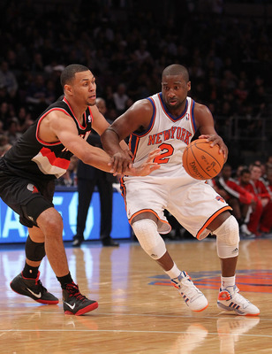 NEW YORK - OCTOBER 30: Raymond Felton #2 of the New York Knicks drives the ball past Brandon Roy #7 of the Portland Trail Blazers at Madison Square Garden on October 30, 2010 in New York City. NOTE TO USER: User expressly acknowledges and agrees that, by