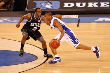 INDIANAPOLIS - APRIL 05:  Nolan Smith #2 of the Duke Blue Devils drives against Shawn Vanzant #2 of the Butler Bulldogs during the 2010 NCAA Division I Men's Basketball National Championship game at Lucas Oil Stadium on April 5, 2010 in Indianapolis, Indi