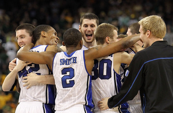 HOUSTON - MARCH 28: (L-R) Ryan Kelly #42, Lance Thomas #42 Nolan Smith #2, Brian Zoubek #55 and Jon Scheyer #30 of the Duke Blue Devils celebrate a win against the Baylor Bears during the south regional final of the 2010 NCAA men's basketball tournament a