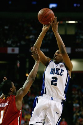ATLANTA - MARCH 14:  Nolan Smith #2 of the Duke Blue Devils shoots a jump shot against Landon Milbourne #1 of the Maryland Terrapins during the semifinals of the 2009 ACC Men's Basketball Tournament on March 14, 2009 at the Georgia Dome in Atlanta, Georgi