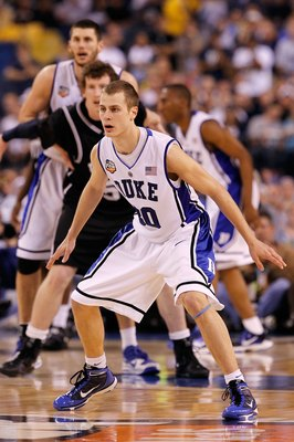 INDIANAPOLIS - APRIL 05:  Jon Scheyer #30 of the Duke Blue Devils defends against the Butler Bulldogs during the 2010 NCAA Division I Men's Basketball National Championship game at Lucas Oil Stadium on April 5, 2010 in Indianapolis, Indiana.  (Photo by Jo
