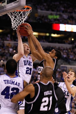 INDIANAPOLIS - APRIL 05:  Miles Plumlee #21 of the Duke Blue Devils fights for a rebound against the Butler Bulldogs during the 2010 NCAA Division I Men's Basketball National Championship game at Lucas Oil Stadium on April 5, 2010 in Indianapolis, Indiana