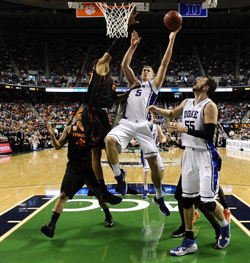 GREENSBORO, NC - MARCH 13:  Mason Plumlee #5 of the Duke Blue Devils shoots against of the University of Miami Hurricanes in their semifinal game in the 2010 ACC Men's Basketball Tournament at the Greensboro Coliseum on on March 13, 2010 in Greensboro, No