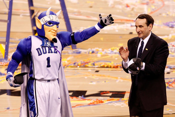INDIANAPOLIS - APRIL 05:  The mascot and head coach Mike Krzyzewski of the Duke Blue Devils celebrate on court after they won 61-59 against the Butler Bulldogs during the 2010 NCAA Division I Men's Basketball National Championship game at Lucas Oil Stadiu