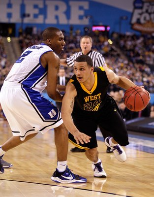 INDIANAPOLIS - APRIL 03:  Joe Mazzulla #24 of the West Virginia Mountaineers moves the ball while taking on the Duke Blue Devils during the National Semifinal game of the 2010 NCAA Division I Men's Basketball Championship at Lucas Oil Stadium on April 3,