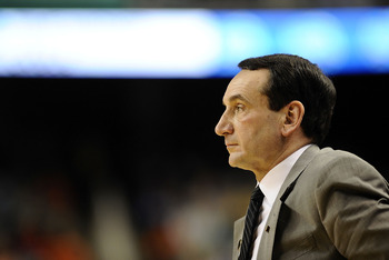 GREENSBORO, NC - MARCH 12:  Head coach Mike Krzyzewski of the Duke Blue Devils walks the bench against  the University of Virginia Cavaliers in their quarterfinal game in the 2010 ACC Men's Basketball Tournament at the Greensboro Coliseum on March 12, 201