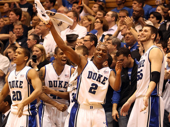 DURHAM, NC - MARCH 06:  Nolan Smith #2 of the Duke Blue Devils celebrates with teammates on the bench during their 82-50 victory over the North Carolina Tar Heels during their game at Cameron Indoor Stadium on March 6, 2010 in Durham, North Carolina.  (Ph