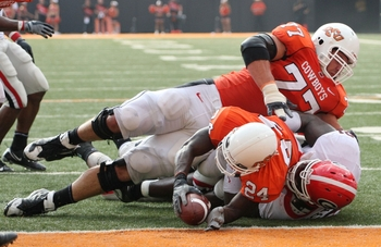 STILLWATER, OK - SEPTEMBER 5:  Running back Kendall Hunter #24 of the Oklahoma State Cowboys is stopped just short of the end zone as teammate Noah Franklin #77 falls on top during the third quarter of the game against the Georgia Bulldogs at Boone Picken