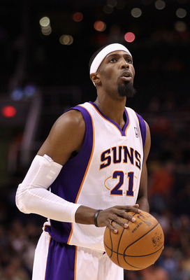 PHOENIX - OCTOBER 12:  Hakim Warrick #21 of the Phoenix Suns shoots a free throw shot during the preseason NBA game against the Utah Jazz at US Airways Center on October 12, 2010 in Phoenix, Arizona. NOTE TO USER: User expressly acknowledges and agrees th