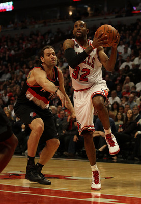 CHICAGO - NOVEMBER 01: C.J. Watson #32 of the Chicago Bulls drives to the basket past Fabricio Oberto #21 of the Portland Trail Blazers at the United Center on November 1, 2010 in Chicago, Illinois. The Bulls defeated the Trail Blazers 110-98. NOTE TO USE