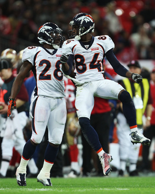 LONDON, ENGLAND - OCTOBER 31:  Brandon Lloyd #84 of Denver Broncos celebrates with Correll Buckhalter #28 of Denver Broncos during the NFL International Series match between Denver Broncos and San Francisco 49ers at Wembley Stadium on October 31, 2010 in