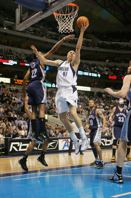 DALLAS - FEBRUARY 7:  Dirk Nowitzki #41 of the Dallas Mavericks goes to the basket against Rudy Gay #22 of the Memphis Grizzlies on February 7, 2007 at American Airlines Center in Dallas, Texas. The Mavs won 113-97.  NOTE TO USER: User expressly acknowled