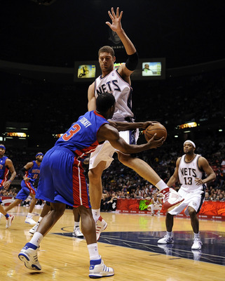 EAST RUTHERFORD, NJ - NOVEMBER 07:  Rodney Stuckey #3 of the Detroit Pistons tries to pass the ball around Brook Lopez #11 of the New Jersey Nets during their game November 7, 2008 at the Izod Arena in East Rutherford, New Jersey.  (Photo by Jeff Zelevans
