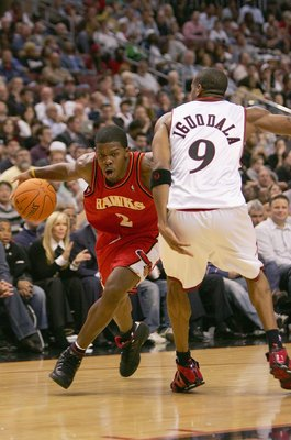 PHILADELPHIA - NOVEMBER 1:  Joe Johnson #2 of the Atlanta Hawks goes up against Andre Iguodala #9 of the Philadelphia 76ers during the game on November 1, 2006 at the Wachovia Center in Philadelphia, Pennsylvania.  The 76ers won 88-75.  NOTE TO USER: User