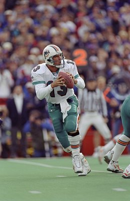 Quarterback Dan Marino #13 of the Miami Dolphins in action during the game against the Buffalo Bills at the Rich Stadium in Orchard Park, New York. The Bills defeated the Dolphins 30-24.