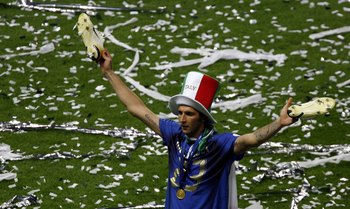 BERLIN - JULY 09:  Marco Materazzi of Italy holds his boots aloft following his team's victory in a penalty shootout at the end of the FIFA World Cup Germany 2006 Final match between Italy and France at the Olympic Stadium on July 9, 2006 in Berlin, Germa