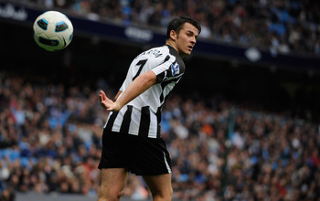 MANCHESTER, ENGLAND - OCTOBER 03: Joey Barton of Newcastle throws the ball during the Barclays Premier League match between Manchester City and Newcastle United at the City of Manchester Stadium on October 3, 2010 in Manchester, England.  (Photo by Michae