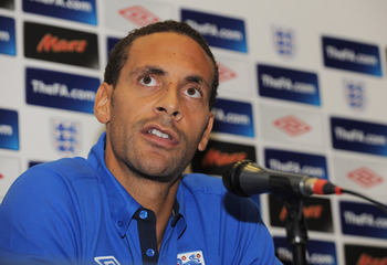 LONDON, ENGLAND - OCTOBER 11: Rio Ferdinand speaks to the press after the England training session at Wembley Stadium on October 11, 2010 in London, England.  (Photo by Michael Regan/Getty Images)