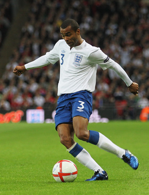 LONDON, ENGLAND - OCTOBER 12:  Ashley Cole of England in action during the UEFA EURO 2012 Group G Qualifying match between England and Montenegro at Wembley Stadium on October 12, 2010 in London, England.  (Photo by Hamish Blair/Getty Images)