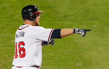 ATLANTA - OCTOBER 11:  Brian McCann #16 of the Atlanta Braves hits solo homer in the sixth inning against the San Francisco Giants during Game Four of the NLDS of the 2010 MLB Playoffs at Turner Field on October 11, 2010 in Atlanta, Georgia.  (Photo by Ke