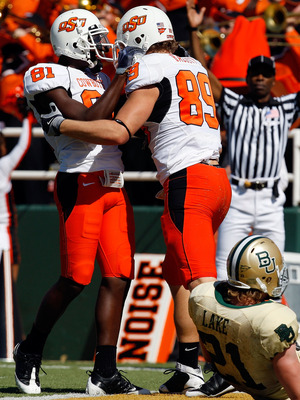 WACO, TX - OCTOBER 24:  Justin Blackmon #81 and Cooper Nicholas #89 of the Oklahoma State Cowboys celebrate a touchdown in front of Jordan Lake #21 of the Baylor Bears at Floyd Casey Stadium on October 24, 2009 in Waco, Texas.  (Photo by Ronald Martinez/G