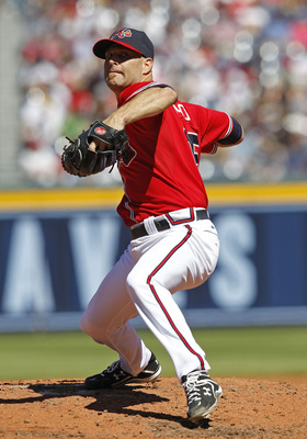 ATLANTA - OCTOBER 03:  Pitcher Tim Hudson #15 of the Atlanta Braves throws a pitch during the game against the Philadelphia Phillies at Turner Field on October 3, 2010 in Atlanta, Georgia.  The Braves beat the Phillies 8-7.  (Photo by Mike Zarrilli/Getty