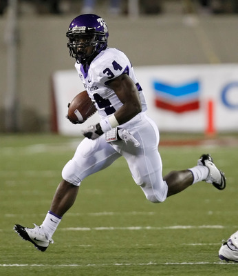 LAS VEGAS - OCTOBER 30:  Ed Wesley #34 of the Texas Christian University Horned Frogs runs for yardage against the UNLV Rebels during their game at Sam Boyd Stadium October 30, 2010 in Las Vegas, Nevada. TCU won 48-6.  (Photo by Ethan Miller/Getty Images)