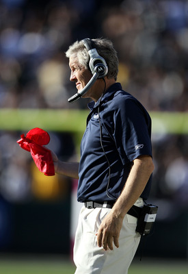 OAKLAND, CA - OCTOBER 31:  Head coach Pete Carroll of the Seattle Seahawks gets ready to throw the red flag after Tyvon Branch of the Oakland Raiders made an interception at Oakland-Alameda County Coliseum on October 31, 2010 in Oakland, California. The c