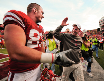 LINCOLN, NE - OCTOBER 30: Coach Bo Pelini of the Nebraska Cornhuskers high fives tight end Ben Cotton #81 after their game against the Missouri Tigers at Memorial Stadium on October 30, 2010 in Lincoln, Nebraska. Nebraska Defeated Missouri 31-17. (Photo b