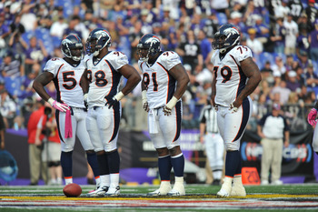 BALTIMORE, MD - OCTOBER 10: The Denver Broncos defense awaits the play during the game against the Baltimore Ravens at M&T Bank Stadium on October 10, 2010 in Baltimore, Maryland. Players wore pink in recognition of Breast Cancer Awareness Month. The Rave